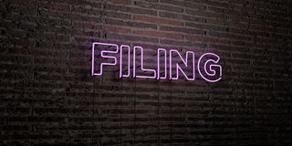 FILING -Realistic Neon Sign on Brick Wall background - 3D rendered royalty free stock image Royalty Free Stock Images