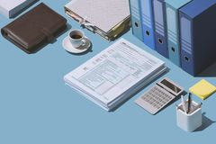 Filing the 1040 tax return form. Filing the 1040 individual income tax return form on the office desk, finance and accounting concept, isometric objects vector illustration