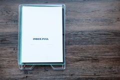 Filing tray with the words Inbox Full. Filing tray with document stating Inbox Full - copy space provided royalty free stock photography