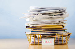 Filing Tray Piled High with Documents Royalty Free Stock Images