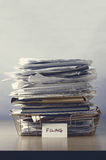 Filing Tray Piled Up with Papers stock images