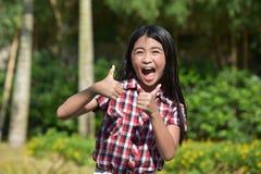 Filipina Adolescent With Thumbs Up foto de stock