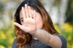 Filipina Adult Female Gesturing Stop jeune image stock