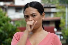 Filipina Female Coughing royalty-vrije stock foto