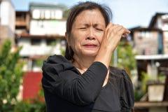 Filipina Female Senior Crying stock foto's