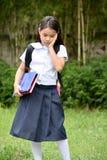 Filipina Female Student With Notebooks novo triste foto de stock royalty free