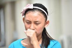 Filipina Girl de toux photographie stock libre de droits