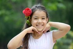 Filipina Girl Smiling With Rose images stock
