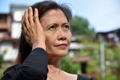 Filipina Granny And Dementia foto de stock royalty free