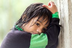 Filipina little girl under the rain Royalty Free Stock Photo