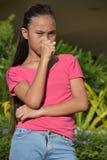 Filipina Teen Girl Coughing joven imagen de archivo