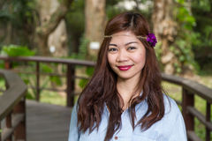 Filipina woman on a bridge in a garden Royalty Free Stock Photos
