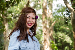Filipina woman in a garden, laughing Stock Image