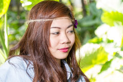 Filipina woman in a garden Stock Image