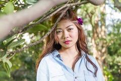 Filipina woman in a garden Royalty Free Stock Photo