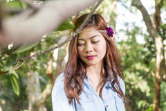 Filipina woman in a garden Royalty Free Stock Photography