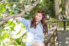 Filipina woman in a garden Stock Photos