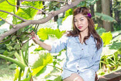 Filipina woman in a garden Royalty Free Stock Photos
