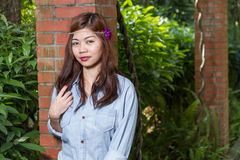 Filipina woman in a garden Royalty Free Stock Image