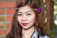 Filipina woman in a garden Stock Photo