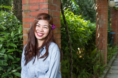 Filipina woman in a garden Royalty Free Stock Images