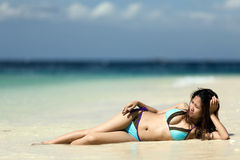 Filipina woman lying on sand Stock Photo