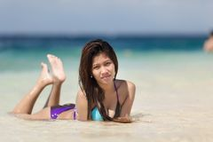 Filipina woman lying on sand Stock Photo