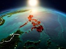 Filipinas no nascer do sol da órbita ilustração royalty free