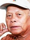 Filipino Asian Senior. Face shot of a charming senior Filipino or Asian man wearing a hat Royalty Free Stock Photos