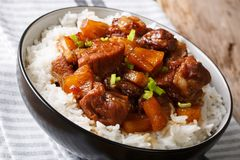 Filipino belly pork hamonado with pineapple and rice close-up. h Stock Images