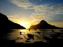 Filipino boats at sunset El Nido, Palawan Philippines Royalty Free Stock Photography