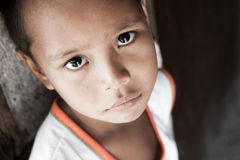 Filipino boy portrait. Portrait of a Filipino boy living in poverty - natural light - Manila, Philippines Stock Photography