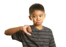 Filipino Boy on White Background with his Thumb down and unhappy expression Stock Photo
