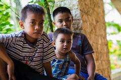 Filipino boys asia sitting watching aid effort earthquake Royalty Free Stock Photography