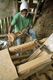 Filipino carving worker working for tourism industry Stock Photos