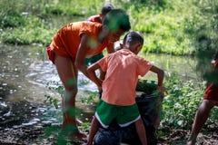 Filipino Children picking up trash near Mount Pinatubo on Aug 27 Royalty Free Stock Photos