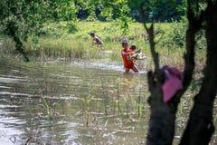 Filipino Children picking up trash near Mount Pinatubo on Aug 27 Royalty Free Stock Images