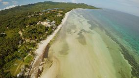 Filipino coast near with sea, Bohol Island, Philippines. Aerial view. Anda city. Filipino coast near with sea, Bohol Island, Philippines. Aerial view stock footage