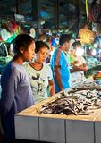 A filipino couple looking at fish inside the public market stock image