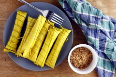 Filipino delicacy food or snack. Locally known as suman or sweet glutinous rice Stock Photo
