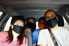 Free Filipino Family With Face Mask On While Inside A Car Royalty Free Stock Images - 187545339