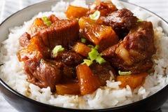Filipino festive meal: Hamonado pork with pineapple and garnish Royalty Free Stock Photo