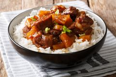 Filipino food: belly pork hamonado with pineapple and rice close Stock Images