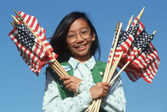 Filipino Girl Scout holding American flags stock photography