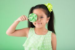 Filipino girl with sugarplum Stock Image