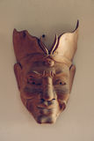 Filipino hand made, wooden tribal mask on the wall.  Royalty Free Stock Photos
