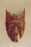 Filipino hand made, wooden tribal mask on the wall.  Royalty Free Stock Images