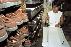 Filipino laborer working in shoe factory. Philippines, island Luzon, National Capital Region of Metro Manila, Marikina City: a man is working in shoe factory Royalty Free Stock Photo