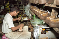 Filipino laborer working in shoe factory. Philippines, island Luzon, National Capital Region of Metro Manila, Marikina City: a man is working in shoe factory Royalty Free Stock Images