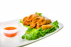 Filipino lumpia served with sauce Stock Photography